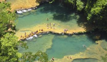 Swim in the crystal pools of Semuc Champey on your Guatemala Tour