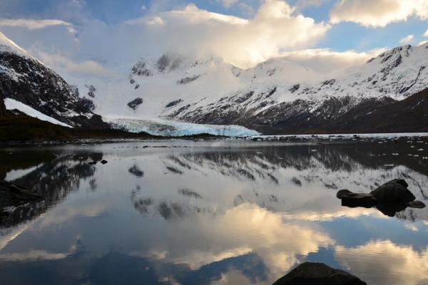 Brookes Glacier sits at the base of large Patagonia mountains