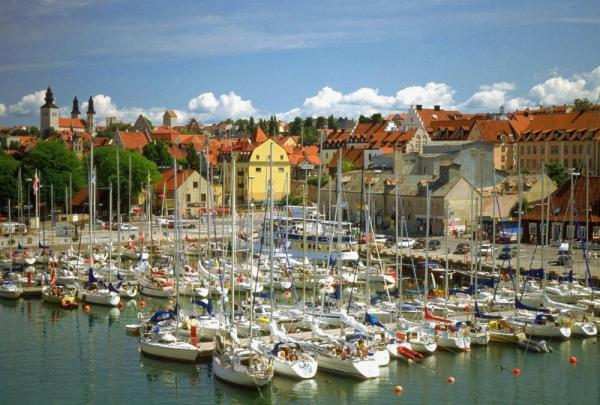 Sailboats docked at harbor in Visby