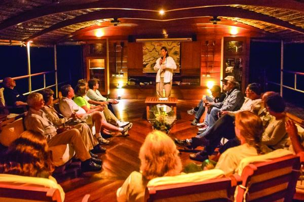 Attend evening programs in the Delfin II's comfortable lounge