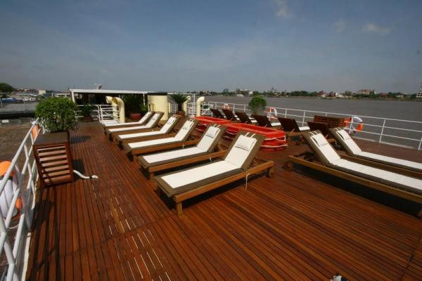 Relax in the sun on the deck of the RV Indochine