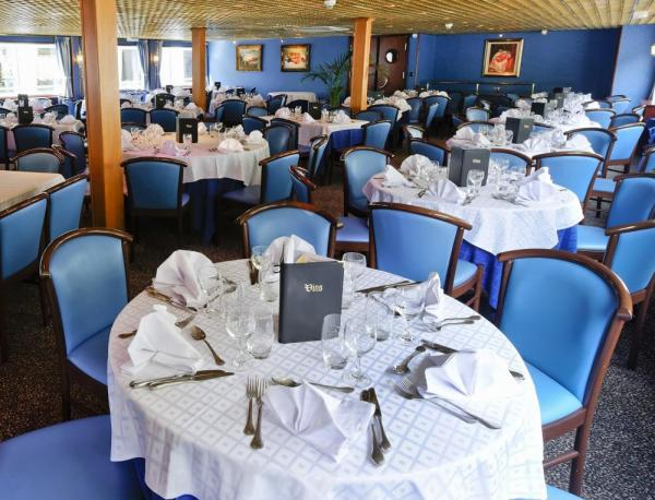 Enjoy fine dining and great conversation in the dining room aboard MS Renoir