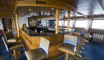 The bar and lounge aboard the Galapagos Legend