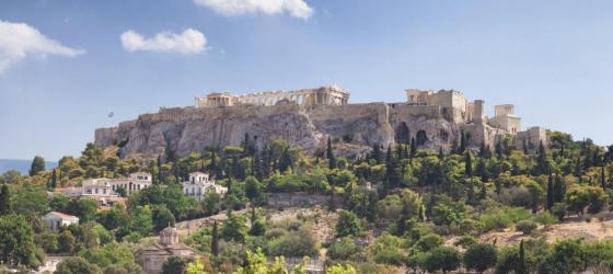 The towering ruins of the Acropolis rise over Athens