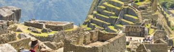 Couple looks out over Machu Picchu