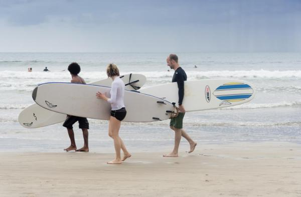Surfers at Tamarindo Beach