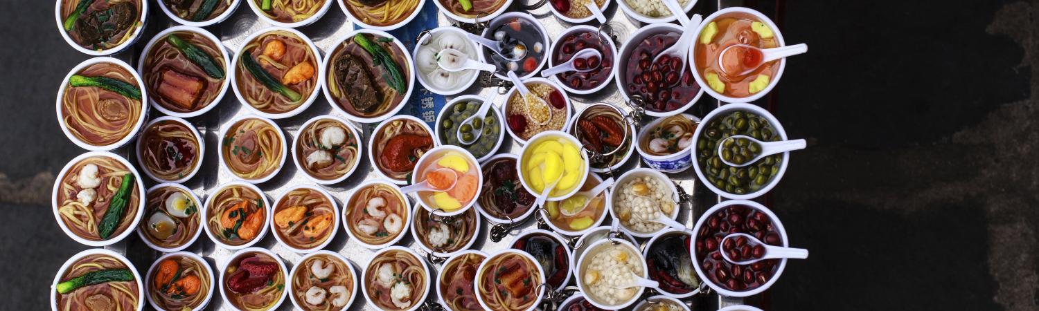 Variety of Vietnamese food offered by a vendor in Hoi An