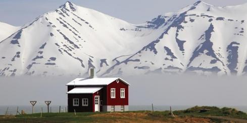 Red house on a fjord in Iceland