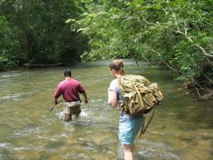 Crossing the Roaring River on the way to the ATM cave entrance