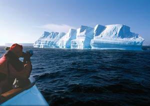 Photograph the blue waters reflecting off the glacial formations