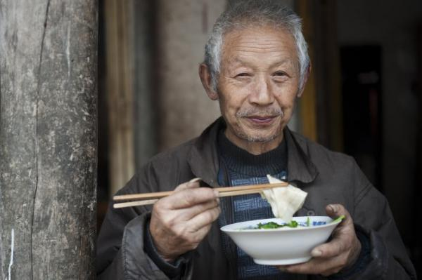 Chinese man enjoying his soup