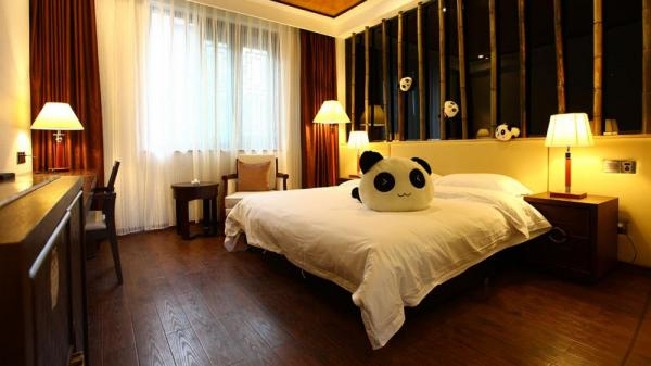 Pandas on bamboo bedpost