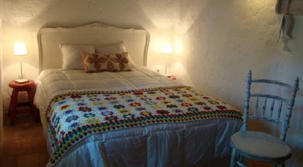 Traditional guestroom with crocheted blankets