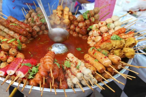 Typical street food in Thailand, meat and seafood on sticks
