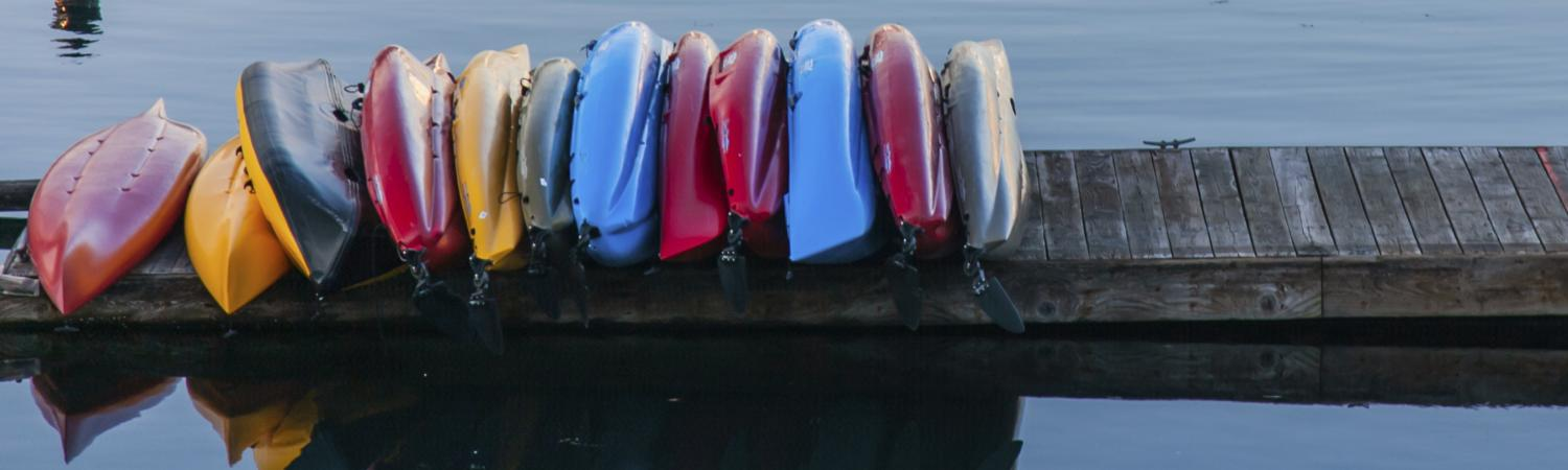Colorful kayaks line the docks of coastal Washington