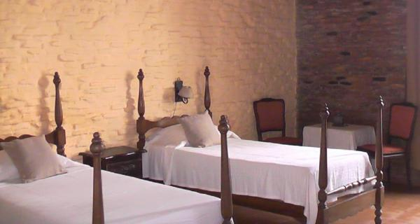 One of two guest rooms at the rustic Estancia Los Platanos