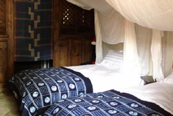 Twin beds and authentic accommodations await the traveler to the Laomadian Lodge