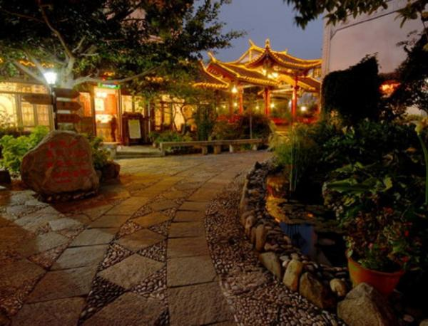 Outdoor night view of the Landscape Hotel and premises