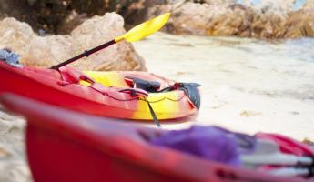 Colorful kayaks on the beach
