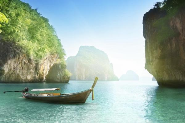 Long-tailed boat on beach of island in Krabi Province