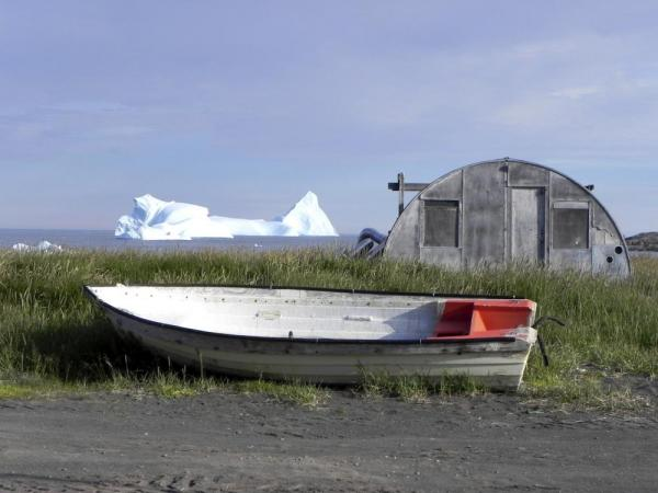 Boat, barn, and iceberg on Disko Bay