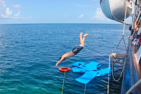 Diving off the side of the s/v Mandalay