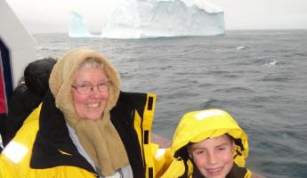 My mom and son in front of their first iceberg