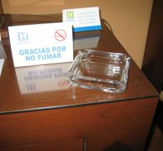 No smoking sign next to an ash tray in our hotel room