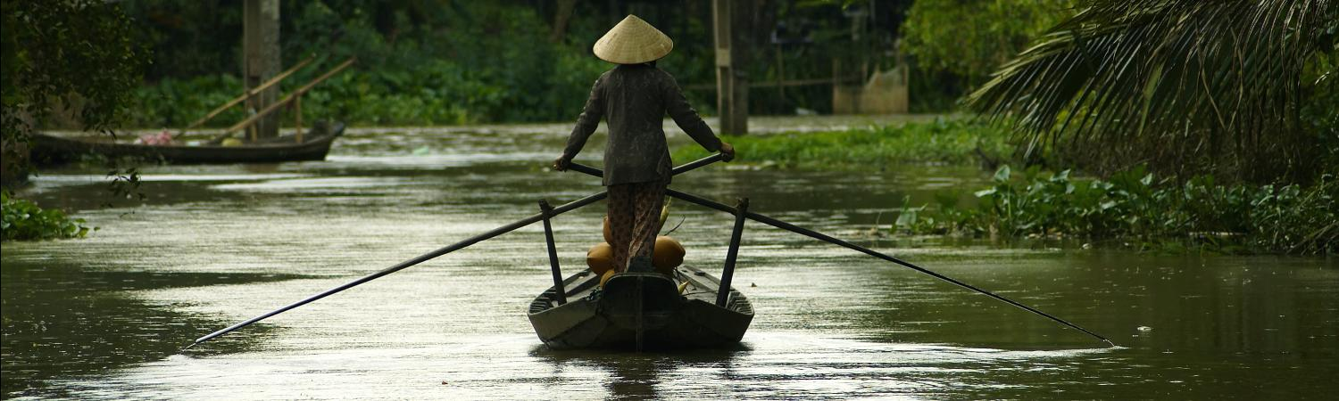 Woman on a boat in Vietnam