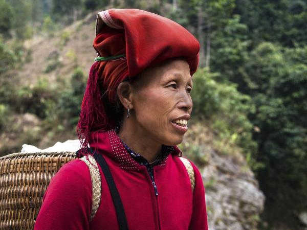 Red Dao woman in traditional headdress, Sapa, Lao Cai