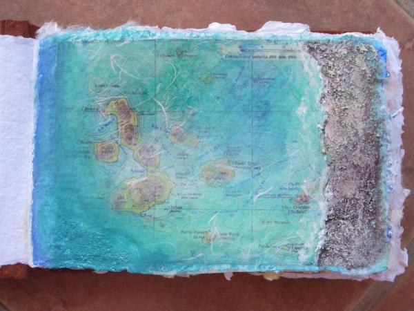 collage and painted map of Galapagos, with sand added for texture