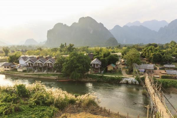 Wooden bridge over River Song, Vang Vieng