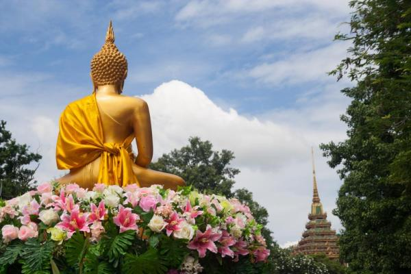 Buddha statue and colorful flowers