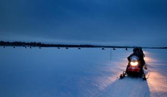Snowmobiling across the Arctic Circle