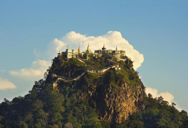 Temple on top of a Mount Popa in the clouds