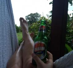 relaxing with a beer in the hammock outside our cabin