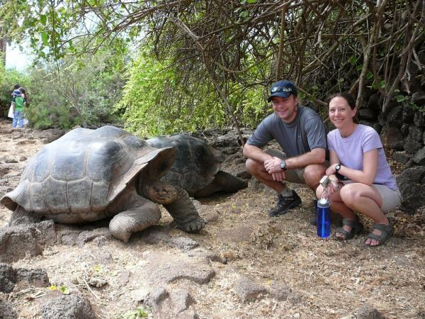 With our favorite tortoise in the Galapagos
