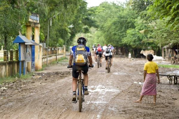 Biking through a village in Cambodia