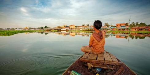Boy on wooden fishing boat