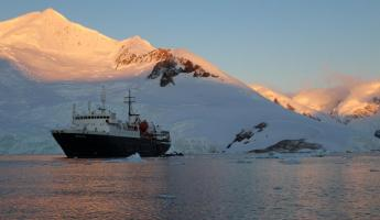 MV Ortelius Sunset at Neko Harbour, Antarctica