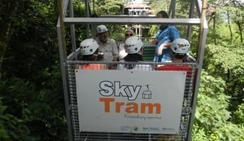Headed up on the tram getting ready to zipline