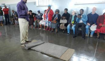 Our guide, a former prisoner of Robben Island describes the harsh conditions