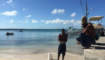 Cleaning conch on the dock in the Bahamas
