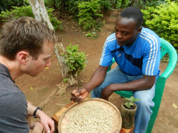 Jos shows us dried coffee beans after they have sat in the sun