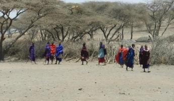 Maasai preparing to perform welcome dance