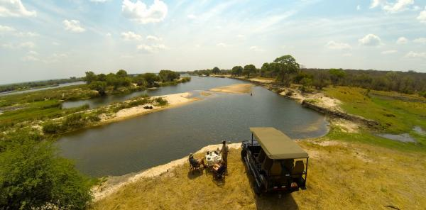 Enjoying a sundowner overlooking the Zambezi River
