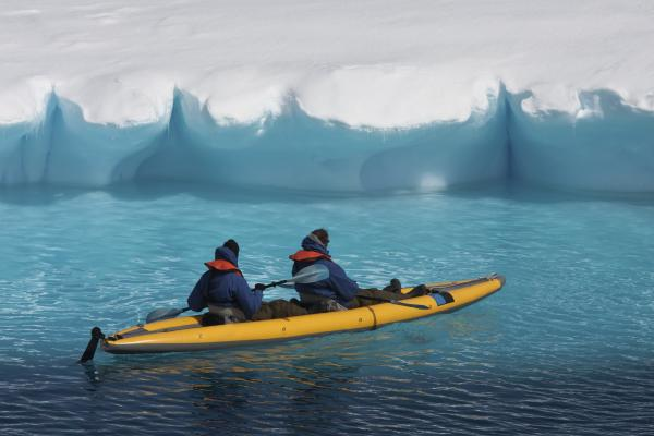 Kayaking by a glacier