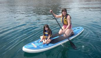 Mom and Daughter Paddle Boarding