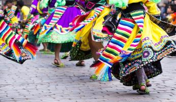 Colorful Peruvian dancers at a parade